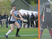 Girls Lacrosse player after the shot. Royalty Free Stock Photo