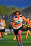Girls Lacrosse race after the ball stock image