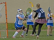 Girls Lacrosse shot on goal Stock Photography