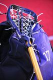 Girls lacrosse stick. Laying on top of a players equipment bag during half time Stock Image