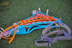 Girls lacrosse stick with goggles. Girls lacrosse stick with and a pair of goggles laying on the ground during half time Royalty Free Stock Photography