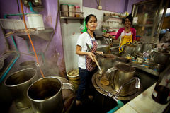 Girls from Lao working on the kitchen Royalty Free Stock Photo