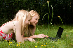 Girls on the laptop Royalty Free Stock Images