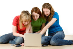 Girls with a laptop Stock Images