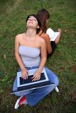 Girls with laptop and book Royalty Free Stock Photography