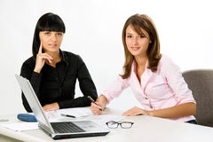 Girls with laptop and document. Attractive young girls with documents and laptop on white background Stock Image
