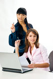 Girls with laptop and document Royalty Free Stock Image
