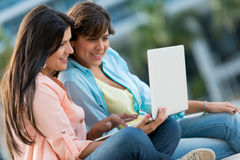 Girls with a laptop outdoors Stock Image