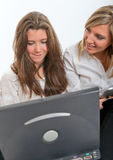 Girls with laptop and tablet pc Stock Images