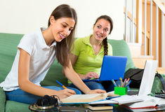 Girls with laptops schooling at home Royalty Free Stock Photos