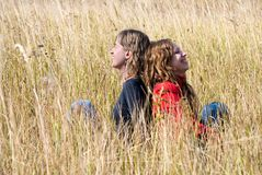 Girls laugh in an autumn field Stock Photo