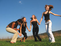 Girls laughing. Girl laughing in group hand in hand Royalty Free Stock Photo
