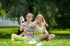 Girls launch paper airplanes Royalty Free Stock Photos
