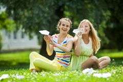 Girls launch paper airplanes Stock Photography
