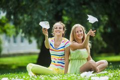 Girls launch paper airplanes Stock Image