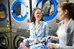 Girls in laundry Stock Images