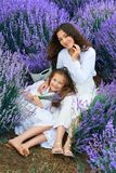 Girls are in the lavender flower field, beautiful summer landscape royalty free stock images