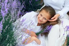 Girls are in the lavender flower field, beautiful summer landscape royalty free stock photography
