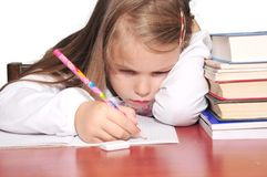 Girls learn buried books Stock Photography