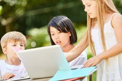Girls learn together at the Tablet PC. In the computer course of a preschool Stock Photos