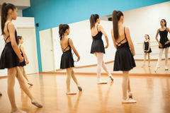 Girls learning a dance routine at school Royalty Free Stock Photography