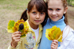 Girls with leaves Stock Photography