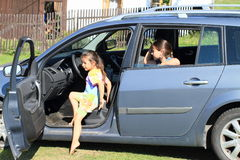 Girls leaving a car Stock Photo