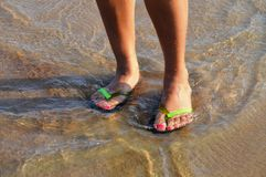Girls leg in the sea wave Stock Photo