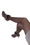 Girls legs. Young girl legs in stockings with high heel shoes Stock Photography