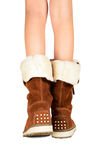Girls legs in boots isolated on the white background Royalty Free Stock Photos
