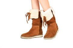 Girls legs in boots side view isolated on the white background Royalty Free Stock Images