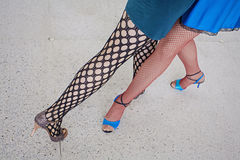 Girls legs. While dancing tango together Royalty Free Stock Image
