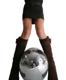 Girls legs and glitterball Stock Photo