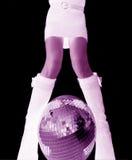 Girls legs and glitterball Stock Photos