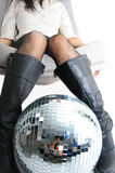 Girls legs and glitterball Stock Photo