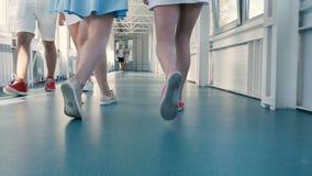 The girls legs goes across the corridor stock footage