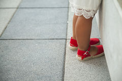 Girls legs with red espadrille shoes Royalty Free Stock Image