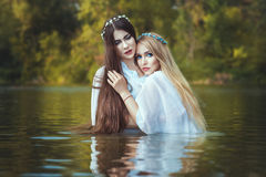 Girls lesbians are embracing. Girls lesbians are embracing, they are in the water Royalty Free Stock Photo