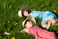 Girls lie on the grass, in nature Stock Photo