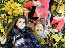 Girls lie on the grass Royalty Free Stock Photography
