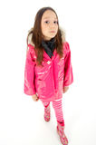 Girls like pink. Young girl posing in a pink raincoat Royalty Free Stock Images