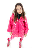 Girls like pink. Young girl posing in a pink raincoat Royalty Free Stock Photo