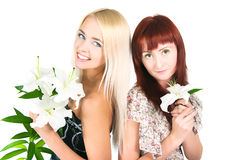 Girls with lilies Stock Photos