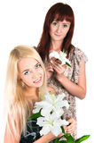 Girls with lilies Royalty Free Stock Images