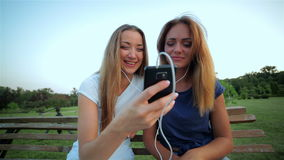 Girls listening to music together on player stock video