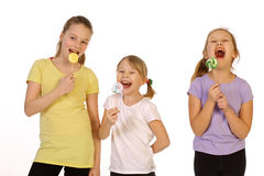 Girls with lollipop on a white background Royalty Free Stock Image
