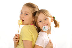 Girls with lollipop on a white background Stock Image