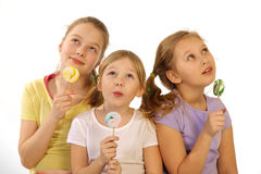 Girls with lollipop on a white background Royalty Free Stock Images