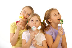 Girls with lollipop on a white background Stock Photography