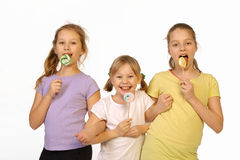 Girls with lollipop on a white background Stock Images